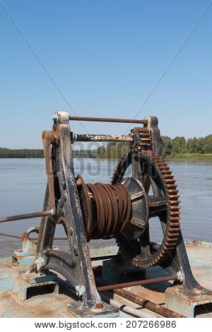 Fluvial Port: Rusted and Old Manual Naval Winch