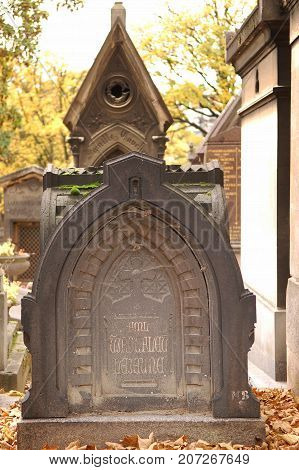 Paris France - November 5 2012: Entrance to an old tomb crypt at a cemetery. Pere Lachaise - world's most visited cemetery attracting hundreds of thousands of visitors annually to graves of those who have enhanced French life over past 200 years.