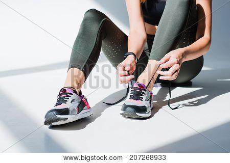 Sportswoman Tying Shoelaces