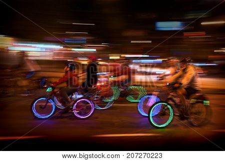 Night Bikes, Vancouver. Participants in a night time bicycle event.