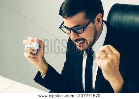 Stressed Senior businessman holding document binders on his head Unsuccessful overworked people
