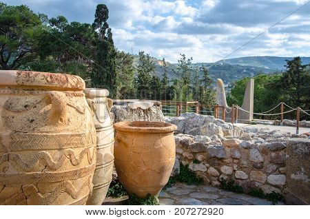 Magazines for food and wine for the minoan royal court at the palace of Knossos with the emblem of minotaur horns at the background, near Heraklion, island of Crete, Greece