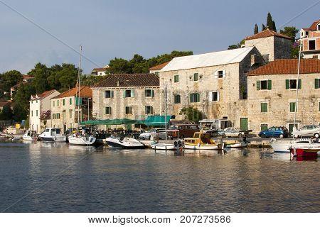 Typical mediterranean stone houses and boats in village Splitska on island Brac in Croatia