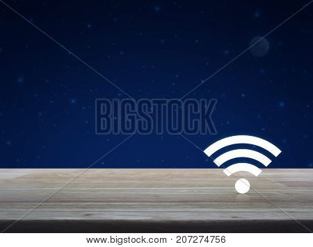 Wi-fi button on wooden table over fantasy night sky and moon Technology and internet concept
