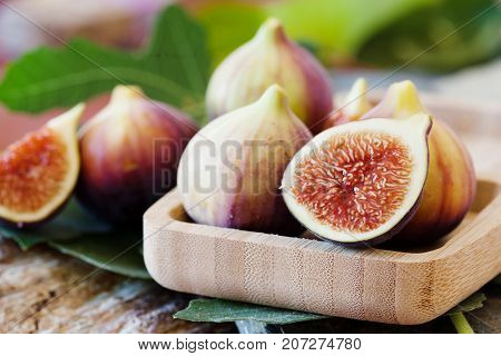 Fresh Figues In Wooden Bowl, Close Up