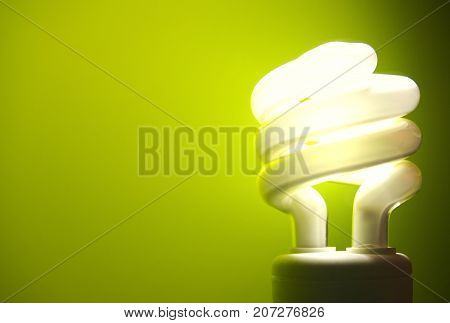 a energy efficient light bulb on a green background.