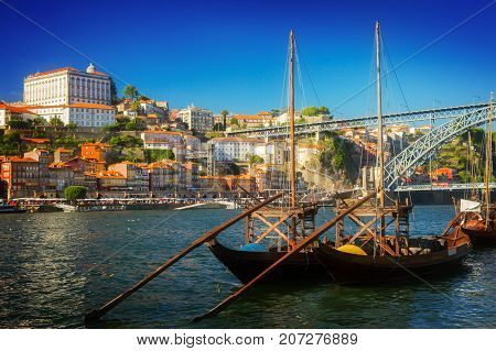 Day scene with Ribeira embankment, Douro river and traditional port wine boats, Porto Portugal, retro toned