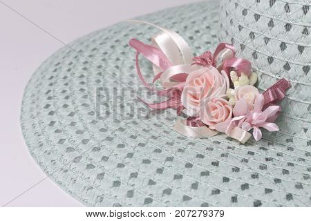 A Broad-brimmed Female Hat Is Light Green, With A Buttonhole. Artificial Flowers In The Form Of Rose