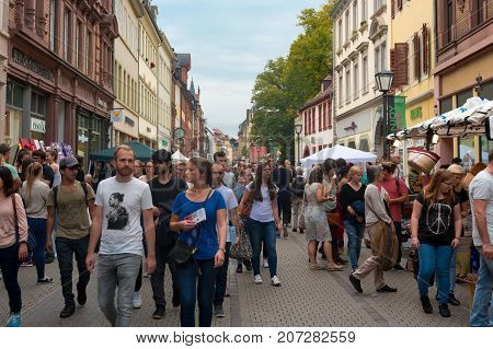 HEIDELBERG, GERMANY - October 1st 2017. People crowd in the pedestrian zone of the Heidelberg old town at the Heidelberg Autumn, the greatest city fall festival.  Autumn a fall folk festival.