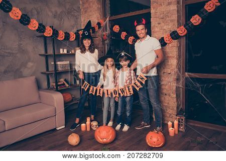 Full Length Of Four Relatives Bonding With Paper Bunting Flags Garland, At Decorated Place Indoors,