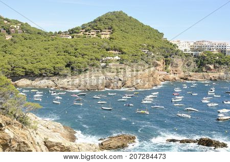 Picturesque view of small cove with ships at the sea in Sa Riera Begur Costa Brava Catalonia northeastern Spain.
