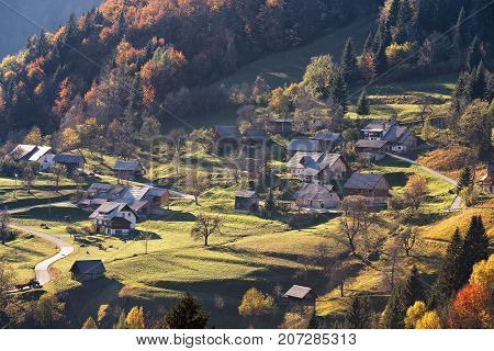 Mountain Village In Alps, Houses On The Hills In Traditional Style