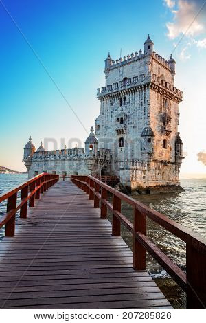 Torre of Belem in sunset light, famouse landmark of Lisbon, Portugal, retro toned
