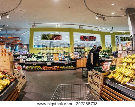 FRANKFURT GERMANY - MAY 3 2017: large selection of fresh vegetables and fruits German Edeka supermarket - shopping for the best fruits and vegetables in the fresh Organic bio store