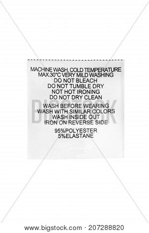 Washing instructions and fabric composition clothes label on white background
