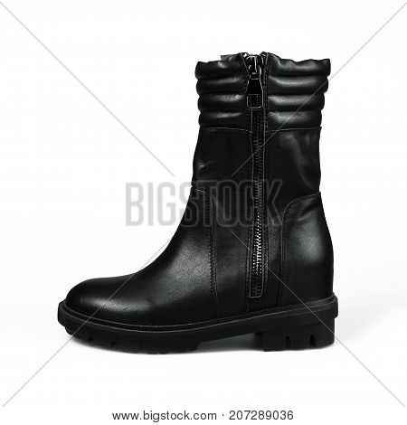 Women's leather black boots on white background isolated studio