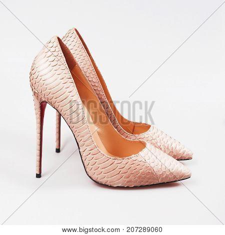 stylish female pink shoes over white background