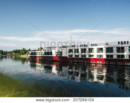 STRASBOURG FRANCE - JUNE 27 2017: River cruising boat in Strasbourg on warm summer day - MS Sound of Music is a deluxe river cruise vessel chartered exclusively by Gate 1 Travel