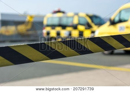 Black And Yellow Barrier Tape At The Airport