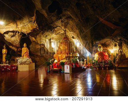 CHIANG RAI THAILAND - JULY 29 2017: Interior of Tham pha jom golden temple in the cave on July 29 2017 in Chiang rai Thailand.