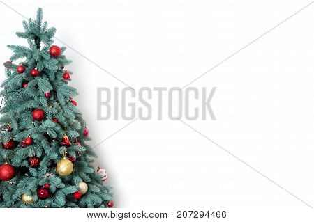 Decorated christmas tree on white background with free space for text