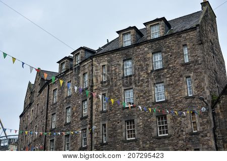 Stone Houses With Colourful Bunting In Edinburgh