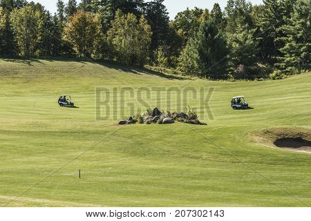 ONTARIO wilno canada 09.09.2017 - golfer golf players playing on green gras on a course outdoor tee shot event Canadian