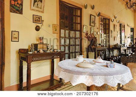 Goa, India - November 16, 2012: Menezes Braganza Pereira House - colonial Villa-Museum of Portuguese era with decoration of 16-18 century. Living room interior