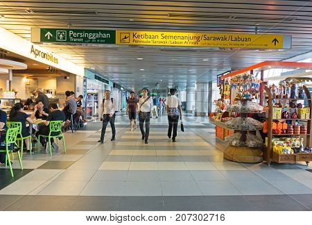 Kota Kinabalu, Malaysia - September 06, 2017: Travelers At Kota Kinabalu International Airport In Sa