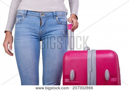 Young girl holding huge pink suitcase and presents on the camera. A roomy and stylish suitcase for girls on a long trip around the world. Close-up of girl with suitcase.