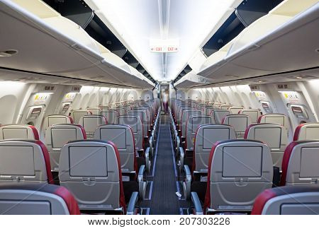 Rows Of Seats And Aisle Of A Commercial Airplane