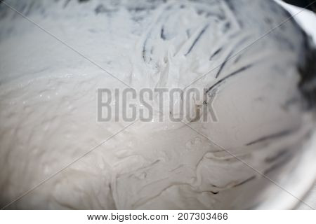 Kind of materials for building. Gloves, spatula, bucket with putty, concrete and other materials. Close-up of objects. Bucket with concrete and cement