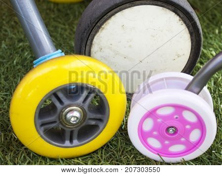 Three different wheels of baby toys and trolley