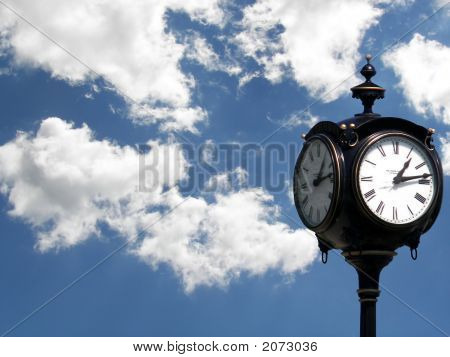 An elegant old clock against a bright summer sky. poster