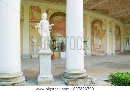 PAVLOVSK RUSSIA - SEPTEMBER 21 2017. Allegorical sculpture of Autumn in Gonzaga Gallery building architectural and fresco ensemble in Pavlovsk St Petersburg Russia