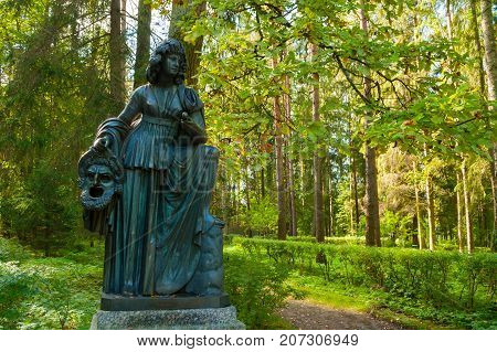 PAVLOVSK ST PETERSBURG RUSSIA - SEPTEMBER 21 2017. Bronze sculpture of Melpomene - the muse of tragedy with a tragic mask. Old Silvia park in Pavlovsk St Petersburg Russia
