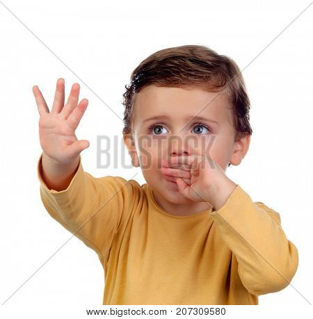 Adorable small child two years old sucking his hand isolated on a white background