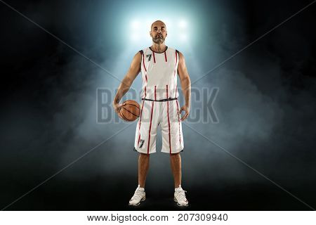 Caucassian Basketball Player in dynamic action with ball in a professional sport game