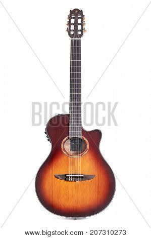 BUDAPEST, HUNGARY - APRIL 09, 2017: Yamaha NX series acoustic guitar on white studio background. Quality nylon string cutaway body instrument.