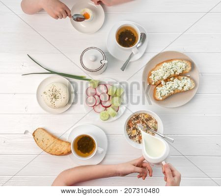 Family eating breakfast , toasts with cottage cheese, topview