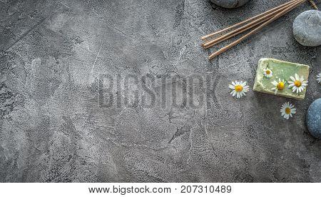 Hot massage pebbles, soap for bathing, topview, copyspace