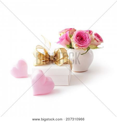 gift box tied with pink ribbon bow, rose flowers. isolated on white background