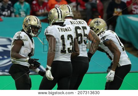 LONDON, ENGLAND - OCTOBER 01 2017: running back Alvin Kamara (41) celebrates scoring a touchdown during the NFL match between the Miami Dolphins and the New Orleans Saints at Wembley Stadium