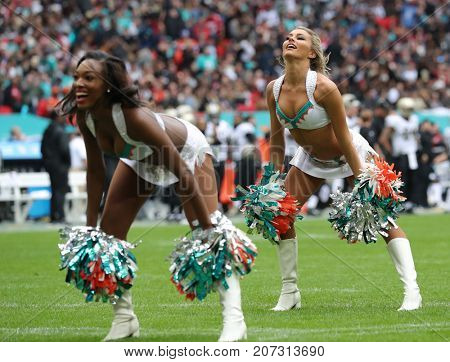 LONDON, ENGLAND - OCTOBER 01 2017: Miami Dolphins Cheerleaders during the NFL match between the Miami Dolphins and the New Orleans Saints at Wembley Stadium in London, United Kingdom.