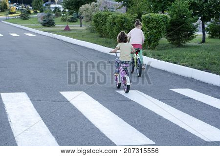 Children on a bicycle crossed a pedestrian crossing