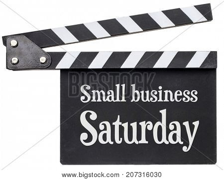 Small business Saturday title in white chalk on clapboard isolated on white