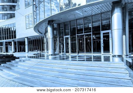Entrance modern office building toned in blue