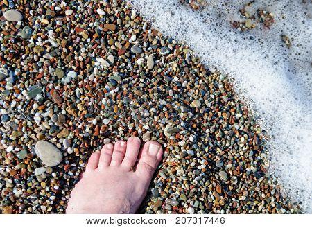 Vacation on sea beach, feet on sea sand,copy space