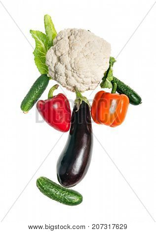 Funny face made of vegetables isolated on white background