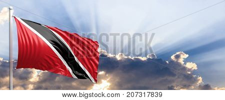 Trinidad and Tobago waving flag on blue sky. 3d illustration
